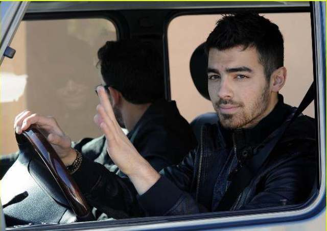 Joe Jonas trying to be a bit grown up with 5 O'Clock shadow, driving a G-Wagon and not wearing his purity ring while out and about in West Hollywood, CaPictured: Joe JonasRef: SPL260984  250311  Picture by: London Entertainment / SplashSplash News and PicturesLos Angeles:	310-821-2666New York:	212-619-2666London:	870-934-2666photodesk@splashnews.com