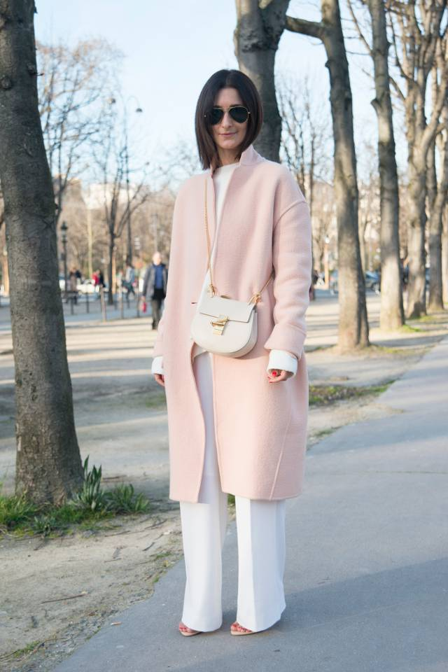PARIS, FRANCE - MARCH 08: Store owner and fashion blogger Golestaneh wears a Celine coat, Zara top and shoes, Fall Winter Spring Summer trousers, Chloe bag and Ray Ban sunglasses on day 6 of Paris Collections: Women on March 08, 2015 in Paris, France.  (Photo by Kirstin Sinclair/Getty Images)*** Local Caption *** Golestaneh