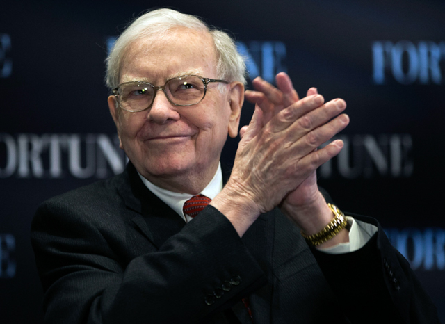 """In this Thursday, May 2, 2013, photo, billionaire investor Warren Buffett applauds as he speaks on the topic of """"Women and Work"""" during a sit-down interview with Fortune's Pattie Sellers in front of an audience at the University of Nebraska at Omaha's College of Business Administration, in Omaha, Neb. Investor Warren Buffett has a knack for explaining what he does in simple terms that sound easy to follow, and his ranking as one of the worldÌs richest billionaires inspires many to copy his moves. But in recent years, copying Buffett has become harder because many of his deals are only possible either because of Berkshire HathawayÌs massive pile of cash or because of BuffettÌs reputation and connections. (AP Photo/Nati Harnik) ORG XMIT: NYBZ164"""