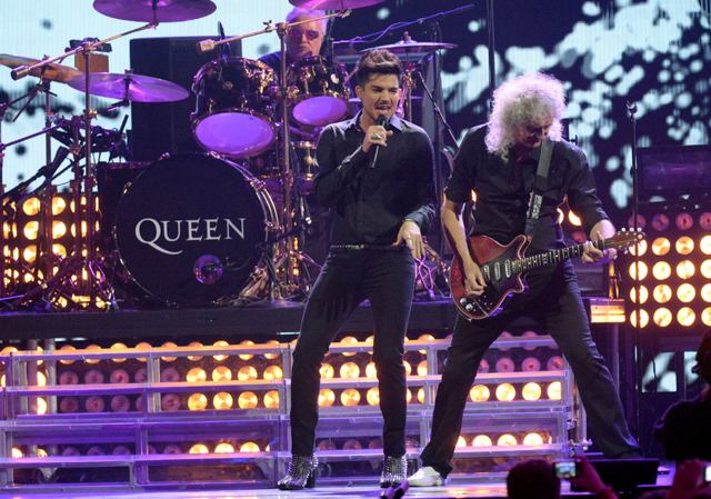 LAS VEGAS, NV - SEPTEMBER 20: Adam Lambert, Roger Taylor and Brian May of Queen performs on day 1 of the iHeartRadio Music Festival at MGM Garden Arena on September 20, 2013 in Las Vegas, Nevada. (Photo by Jeff Kravitz/FilmMagic)