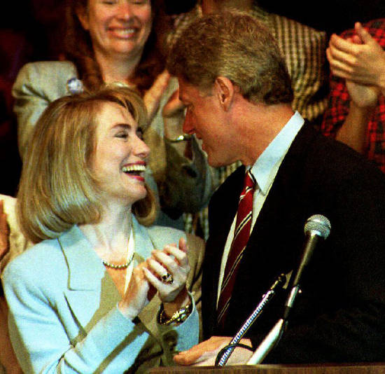 NEW YORK, NY - JULY 14:  Certain Democratic presidential nominee Bill Clinton (R) is applauded by his wife Hillary 14 July 1992, before his address to the Women's Caucus of the 1992 Democratic National Convention, New York. Clinton is campaigning in New York along with his running mate Sen. Al Gore.  (Photo credit should read MARK PHILLIPS/AFP/Getty Images)