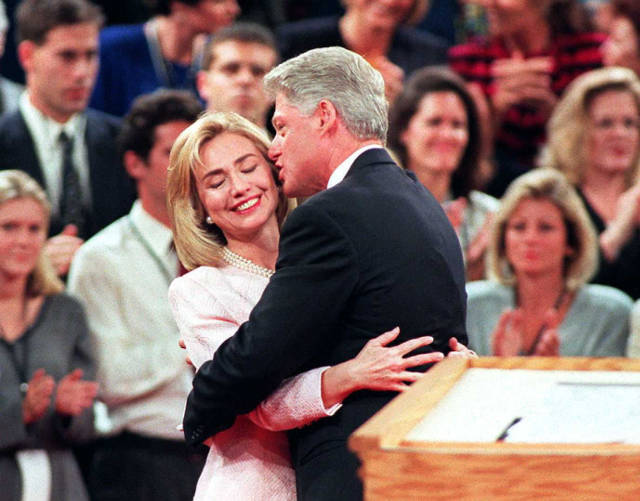 SAN DIEGO, :  US President Bill Clinton (R) gets a hug from his wife Hillary after the presidential debate 16 October at Shiley Theater at the University of San Diego in California.  This is the last debate prior to the 05 presidential election.  AFP PHOTO   Vince BUCCI (Photo credit should read Vince Bucci/AFP/Getty Images)