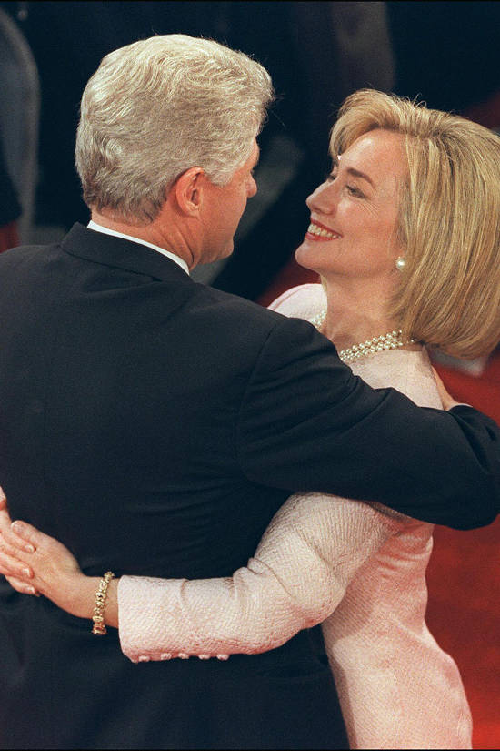 SAN DIEGO, :  US President Bill Clinton (l) in picture taken 16 October 1996 in San Diego gets a hug from his wife Hillary after the presidential debate with Republican candidate Bob Dole Shiley Theater. (Photo credit should read MIKE NELSON/AFP/Getty Images)