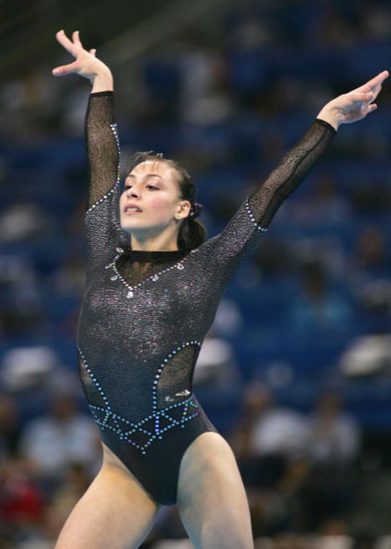 ATHENS - AUGUST 23:  Catalina Ponor of Romania competes in the women's artistic gymnastics floor exercise finals on August 23, 2004 during the Athens 2004 Summer Olympic Games at the Olympic Sports Complex Indoor Hall in Athens, Greece. (Photo by Ezra Shaw/Getty Images)