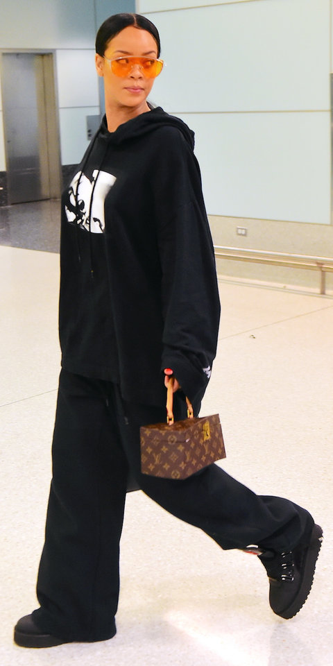 EXCLUSIVE: Rihanna was spotted catching a flight out of JFK Airport in NYC on Sunday night. She wore her own Fenty x Puma Designs , head to toe, as she dressed comfy for the long international flight. She is showing her Spring/ Summer 2017 Collection at Paris Fashion Week. She carried her Louis Vuitton Frank Gehry Twisted bag and wore Gentle Monster x Opening Ceremony Zhora Sunglasses as she walked through the terminal for her flight. Pictured: Rihanna Ref: SPL1362276 250916 EXCLUSIVE Picture by: 247PAPS.TV / Splash News Splash News and Pictures Los Angeles: 310-821-2666 New York: 212-619-2666 London: 870-934-2666 photodesk@splashnews.com